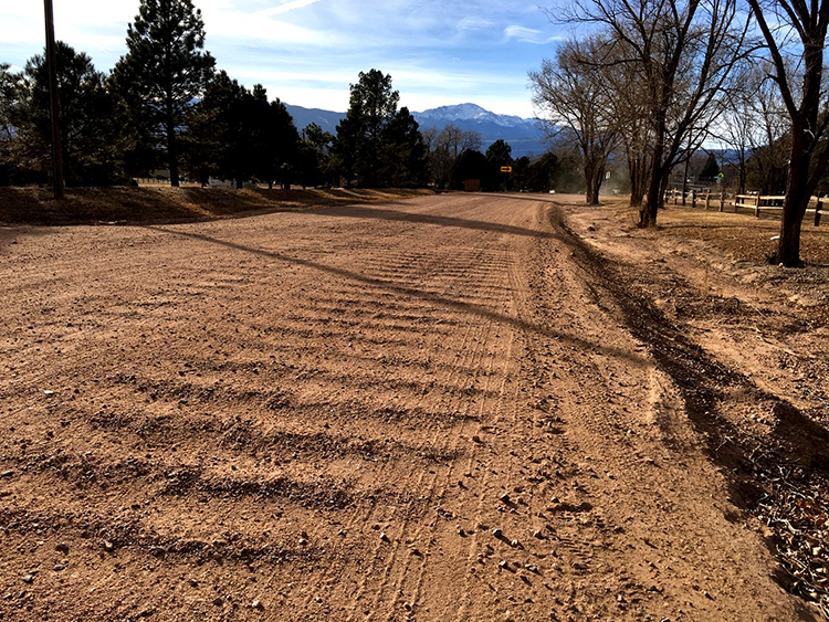 Dirt road showing washboard wind erosion